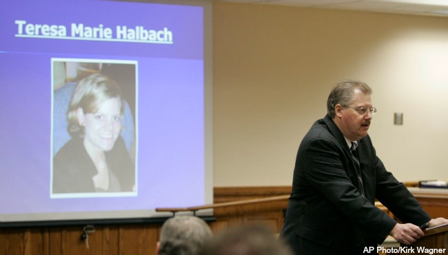 With a photo of homicide victim Teresa Halbach projected behind him, Calumet County District Attorney Ken Kratz begins his opening statements in  Steven Avery's murder trial at the Calumet County Courthouse, Monday, Feb. 12, 2007. (AP Photo/Kirk...