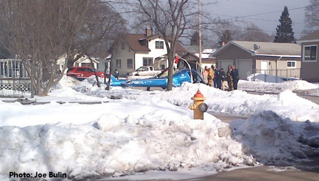 A helicopter crashed on a residential street in Menominee, Mich. on Feb. 12, 2016.