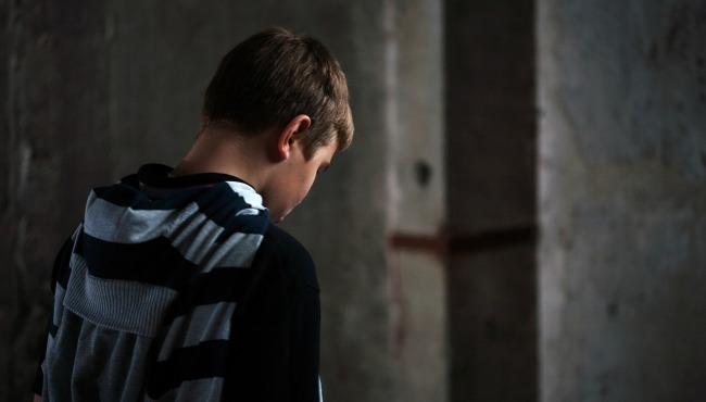 Depressed young teen boy_38612