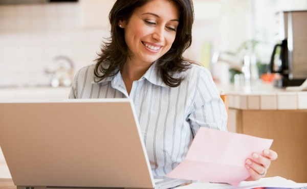 woman working on finances paying bills_40914