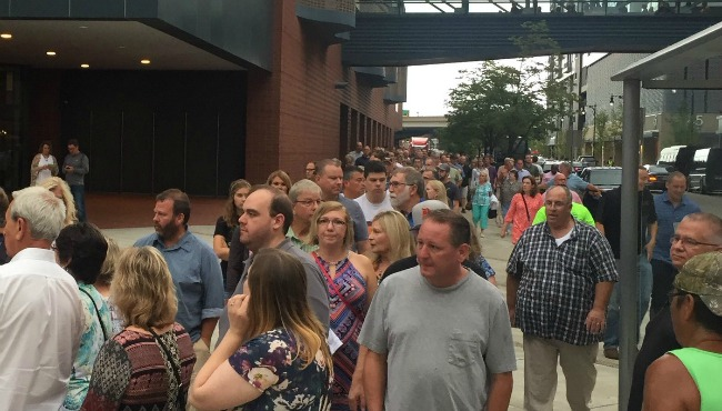 Fans line up outside Van Andel Arena before Paul McCartney's show on Aug. 15, 2016.