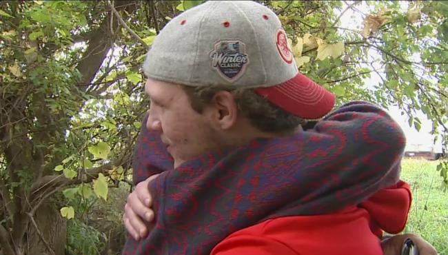 John Bentley hugging stranger-102116_255030