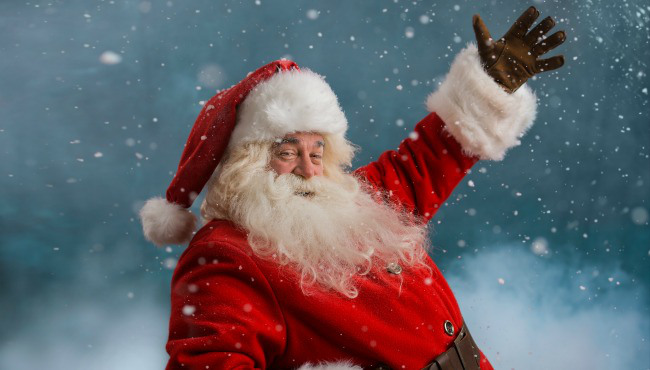 Happy Santa Claus laughing while standing outdoors at North Pole_32653