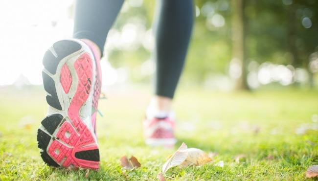 Close up picture of pink sole from running shoe in a park on a sunny day_53976