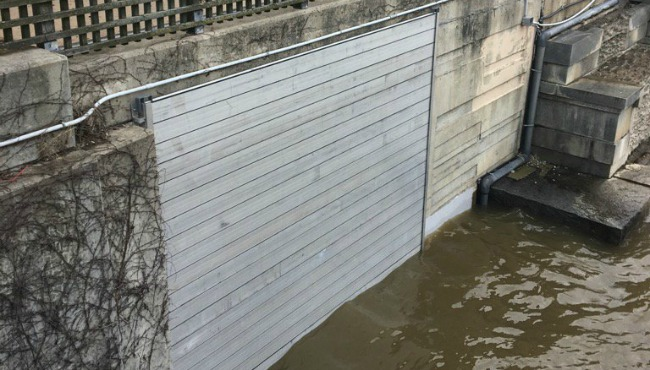 grand river grand rapids flood wall plaza towers door 041017_319269
