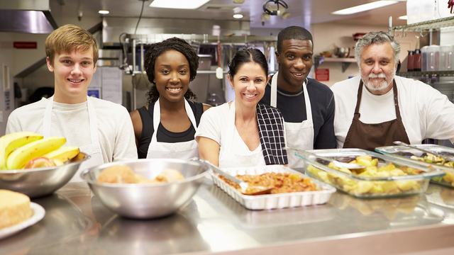 Portrait Of Kitchen Staff In Homeless Shelter_429381