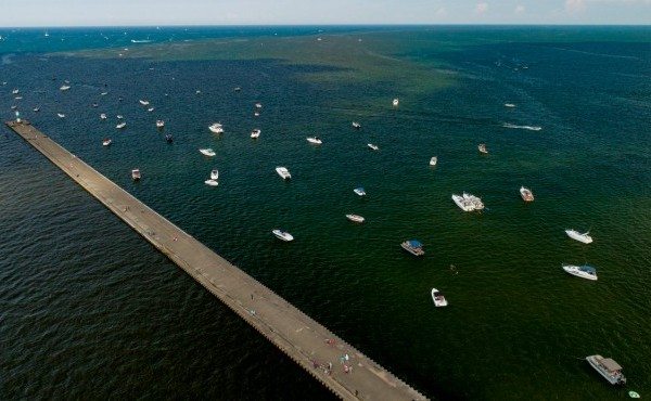 ships floating along Grand Haven pier during Coast Guard Festival 2018