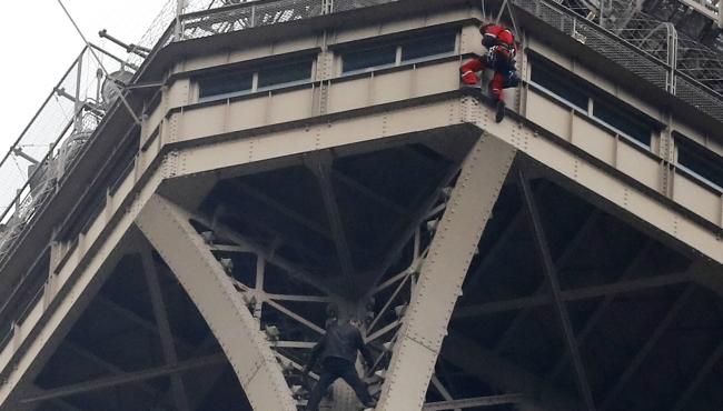 Eiffel Tower Man Climbing 05202019_1558380932959.jpg.jpg