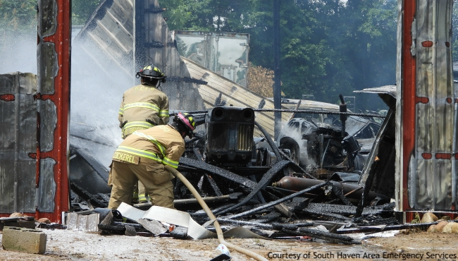 A photo of firefighters battling a fire in Bangor Township. Courtesy of South Haven Area Emergency Services. (June 30, 2019)
