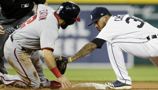 Washington Nationals' Adam Eaton (2) is tagged out by second baseman Detroit Tigers' Harold Castro (30) while trying to advance to second base on a fly out by Anthony Rendon during the eighth inning of a baseball game Friday, June 28, 2019, in Detroit. (AP Photo/Duane Burleson)