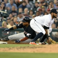 Cleveland Indians' Jose Ramirez, left, slides into third base with a triple past Detroit Tigers' Dawel Lugo in the top of the fifth inning of a baseball game, Friday, June 14, 2019, in Detroit. (AP Photo/Jose Juarez)