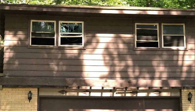 Broken windows at Kentwood home set on fire