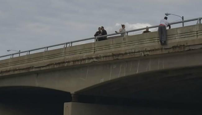 US 31 Apple Avenue Muskegon man dangling