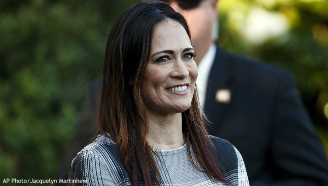 In this June 21, 2019 photo, Stephanie Grisham, spokeswoman for first lady Melania Trump, watches as President Donald Trump and the first lady greet attendees during the annual Congressional Picnic on the South Lawn in Washington. First lady Melania Trump has announced that Grisham will be the new White House press secretary. Grisham, who has been with President Donald Trump since 2015, will also take on the role of White House communications director. (AP Photo/Jacquelyn Martin)