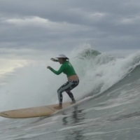 A photo of golfer Tiff Joh surfing. (Courtesy of Tiff Joh)