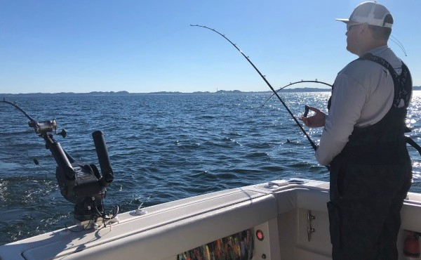 Man fishes on Lake Michigan in Grand Haven
