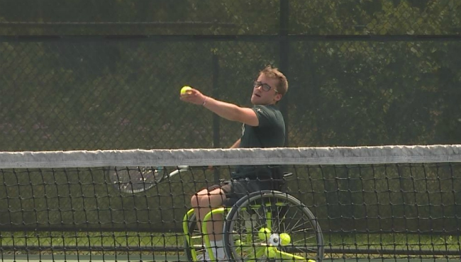 A photo of Chris Kelley practicing tennis. (July 11, 2019)