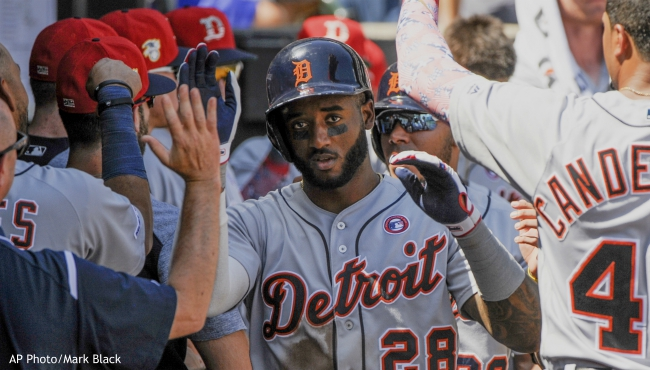 Detroit Tigers celebrate a two-run home run by Detroit Tigers Niko Goodrum (28) against the Chicago White Sox during the sixth inning of a baseball game Thursday, July 4, 2019, in Chicago. (AP Photo/Mark Black)