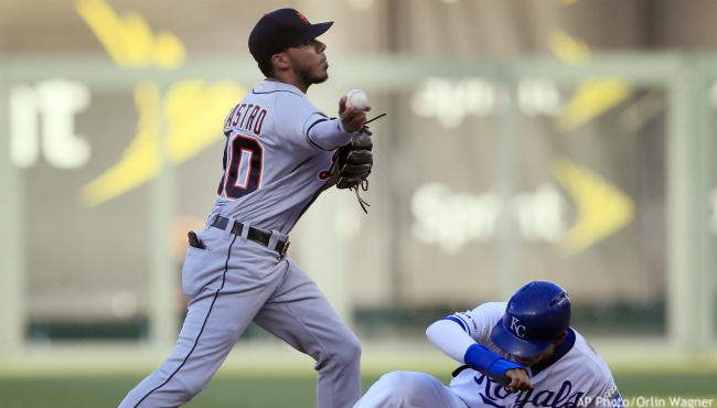 Detroit Tigers second baseman Harold Castro (30) turns a double play after forcing out Kansas City Royals' Nicky Lopez (1) during the fifth inning of a baseball game at Kauffman Stadium in Kansas City, Mo., Saturday, July 13, 2019. Martin Maldonado was out at first. (AP Photo/Orlin Wagner)
