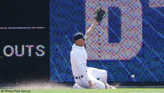 Detroit Tigers center fielder JaCoby Jones can't reach a Philadelphia Phillies' Rhys Hoskins fly ball that went for a triple in the first inning of a baseball game in Detroit, Wednesday, July 24, 2019. (AP Photo/Paul Sancya)