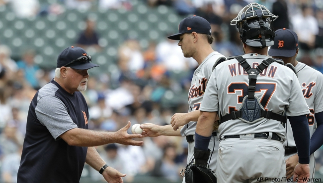 Detroit Tigers starting pitcher Tyler Alexander, second from left, is pulled by manager Ron Gardenhire, left, during the fifth inning of a baseball game, Saturday, July 27, 2019, in Seattle. (AP Photo/Ted S. Warren)
