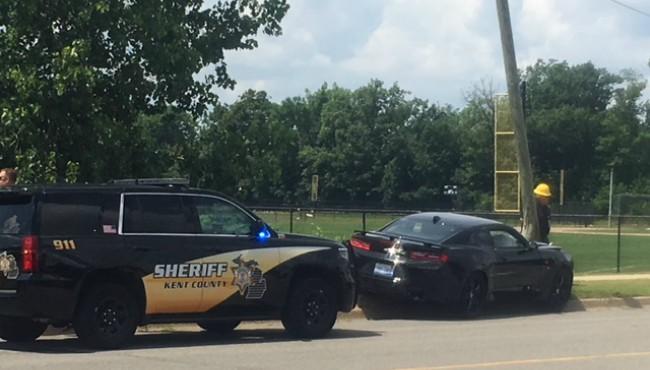Kent County deputy cruiser stopped behind crashed car