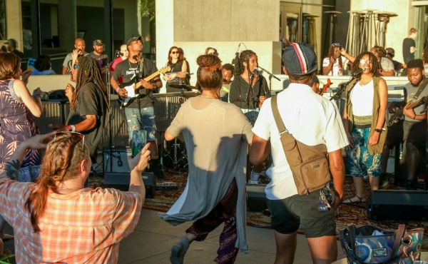 People gathered Thursday for GRAM on the Green, a free outdoor concert at the Grand Rapids Art Museum.
