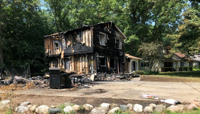 charred home after fire