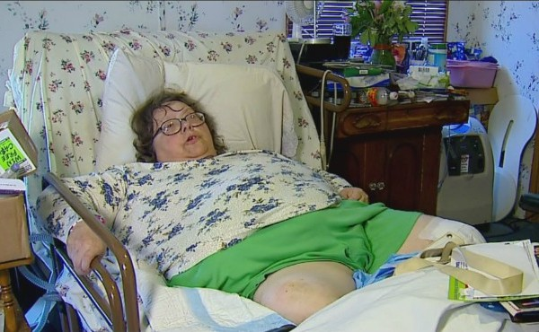 Lynette Moore rests in her bed