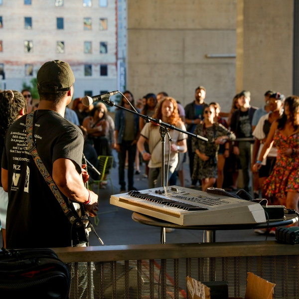 People gathered Thursday for GRAM on the Green, a free outdoor concert at the Grand Rapids Art Museum. (Michael Buck/WOOD TV8)