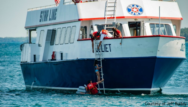 A photo of a girl being rescued by the Star Line Mackinac Island Ferry. (Courtesy of Jeff Burley)