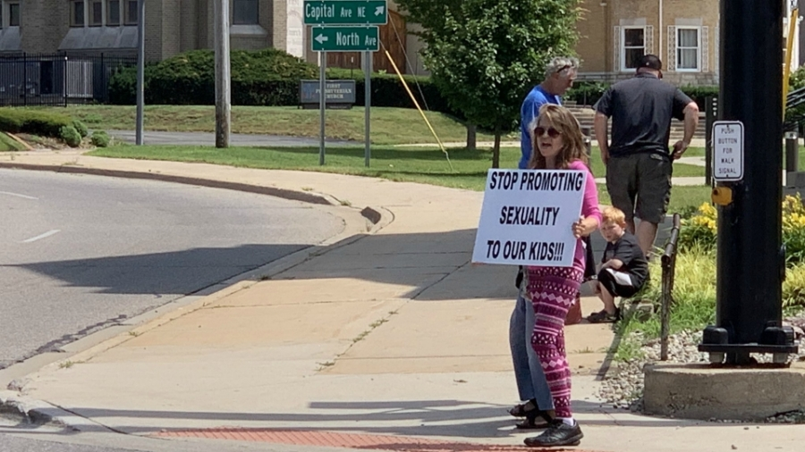 battle creek pride sidewalks painted protester