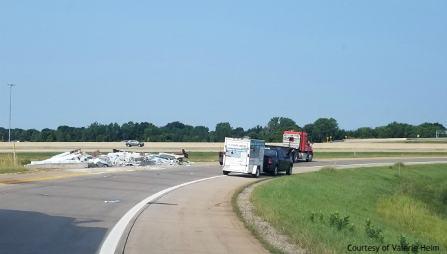 A July 25, 2019 photo sent to ReportIt shows debris on the side of the eastbound M-6 ramp to northbound US-131 after a flatbed lost its load of prefabricated cement. (Valerie Heim/ReportIt)