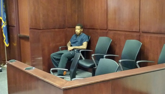 Dayvon Davis staring while sitting in chair in courtroom