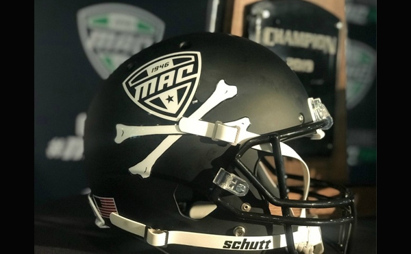 Display helmet with Mid-American Conference logo sits on table