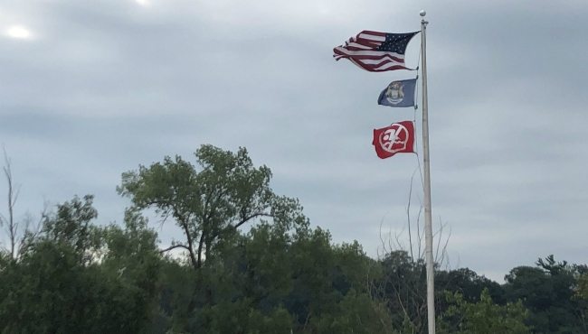 A photo of a red flag at Grand Haven.