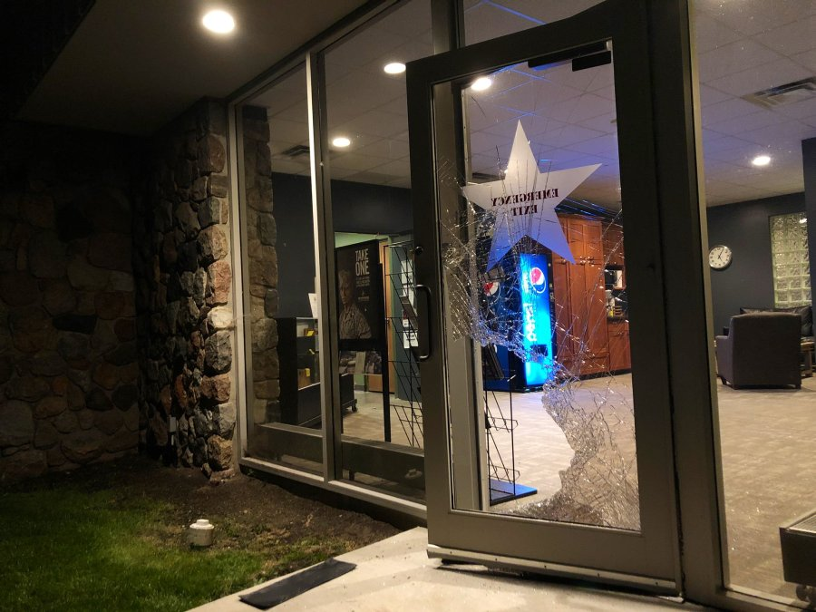 shattered glass door to store