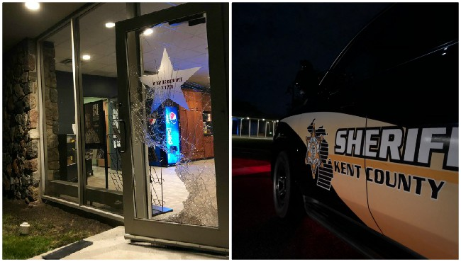 Shattered glass door to store partially open and kent county sheriff cruiser parked outside store