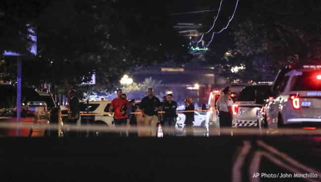 Crime tape surrounds police shooting investigators