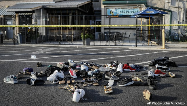 Pile of shoes surrounded by crime tape