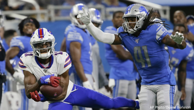 Buffalo Bills wide receiver Zay Jones (11) pulls in a reception next to Detroit Lions defensive back Johnathan Alston during the second half of an NFL preseason football game in Detroit, Friday, Aug. 23, 2019. (AP Photo/Duane Burleson)
