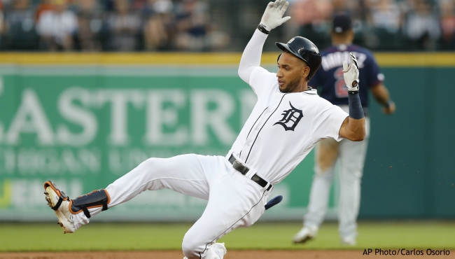 Detroit Tigers' Victor Reyes slides into second for a double during the first inning of the team's baseball game against the Minnesota Twins, Friday, Aug. 30, 2019, in Detroit. (AP Photo/Carlos Osorio)