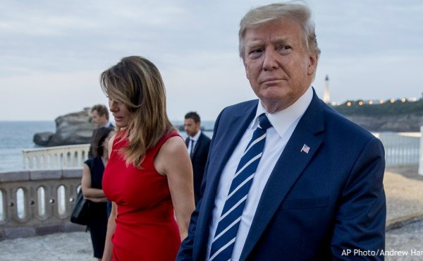 Melanie Trump hold hands and walks with President Donald Trump