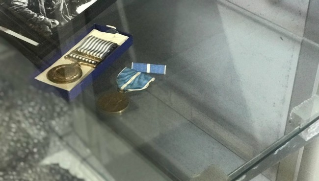 Glass case with two medals