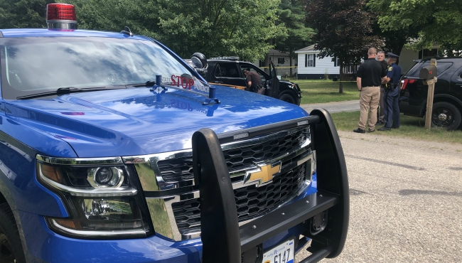 Michigan State Police cruiser at homicide scene