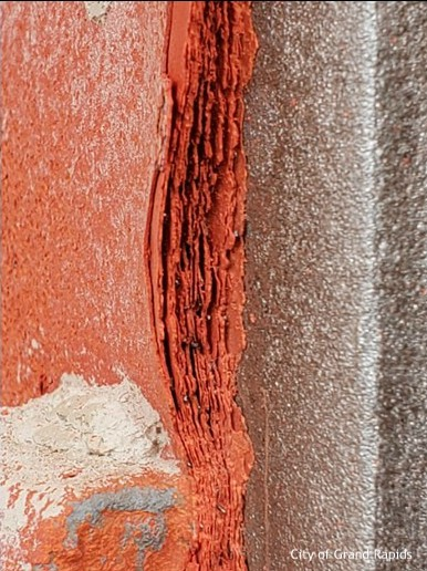 layers of red paint on metal