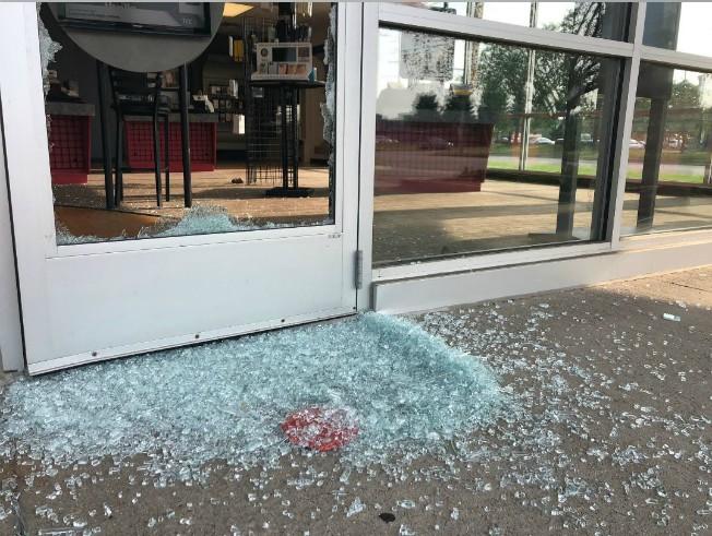 shattered glass from door on sidewalk