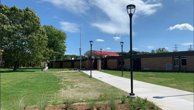sidewalk leads to saranac school