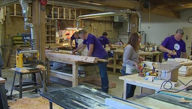 Volunteers build bunk beds for W MI foster families