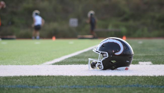 helmet on sideline of field